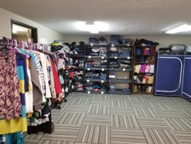 room with clothing on racks
